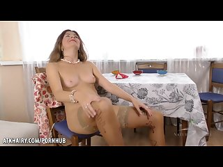 Hairy housewife masturbates on kitchen table