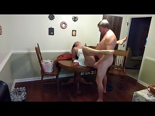 Sexy milf in a sundress gets fucked and creampied on the dining table