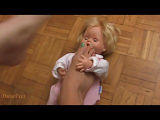 Doll trample with bare feet and heels