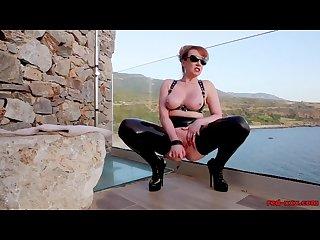 Mature british redhead masturbating on the balcony