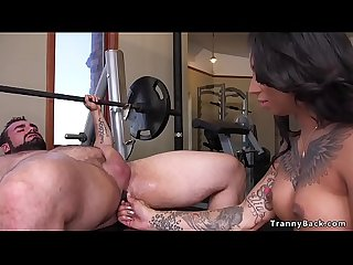 Tranny fitness instructor fucks muscled guy