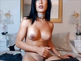 Hot tranny brunette jerking off
