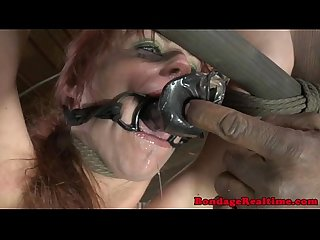 NT sub gagging on a big dildo
