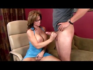 Spex Milf fingers herself as she tugs cock