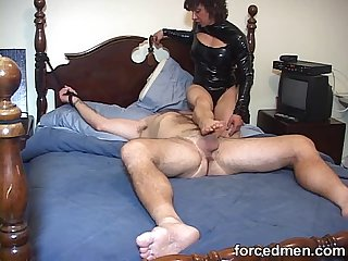 Mistress hardens horny man's cock just by teasing it through the end