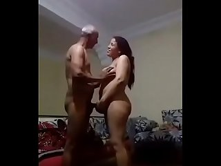 Young woman sucking the penis of an old man