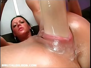 Brunette amateur has her pussy gaped by gigantic dildo