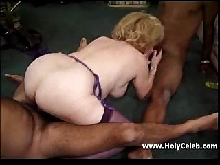 Horny busty granny takes care of the young black virgin