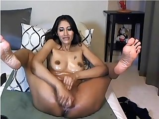 Asian hottie enjoys her big dildo