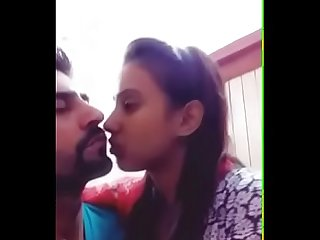 Indian newly married couple smooch