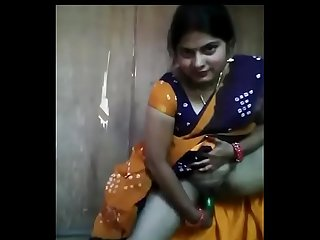 Indian Aunty inserting cucumber in pussy